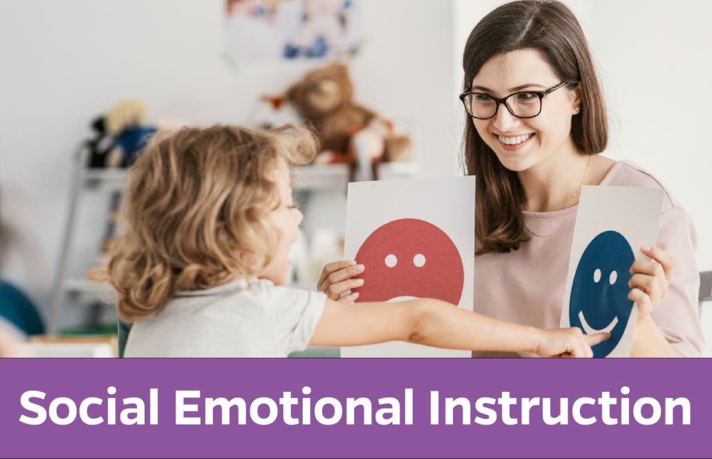 Social Emotional Instruction: Counselor helps young child identity happy face