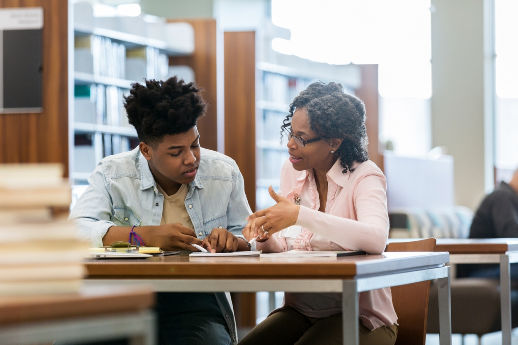 Teenage boy receives help from tutor