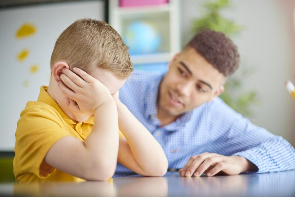 Teacher comforting upset student