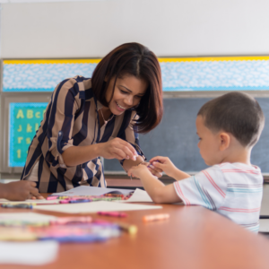 Special Education Teacher works with young student